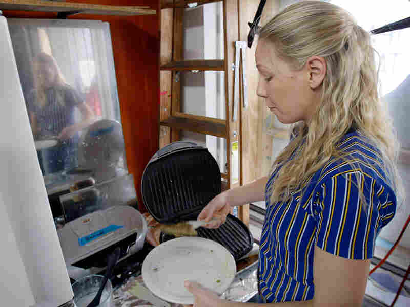 Dawn Weleski grills ground beef for Conflict Kitchen's Iranian kubideh wrap sandwiches.
