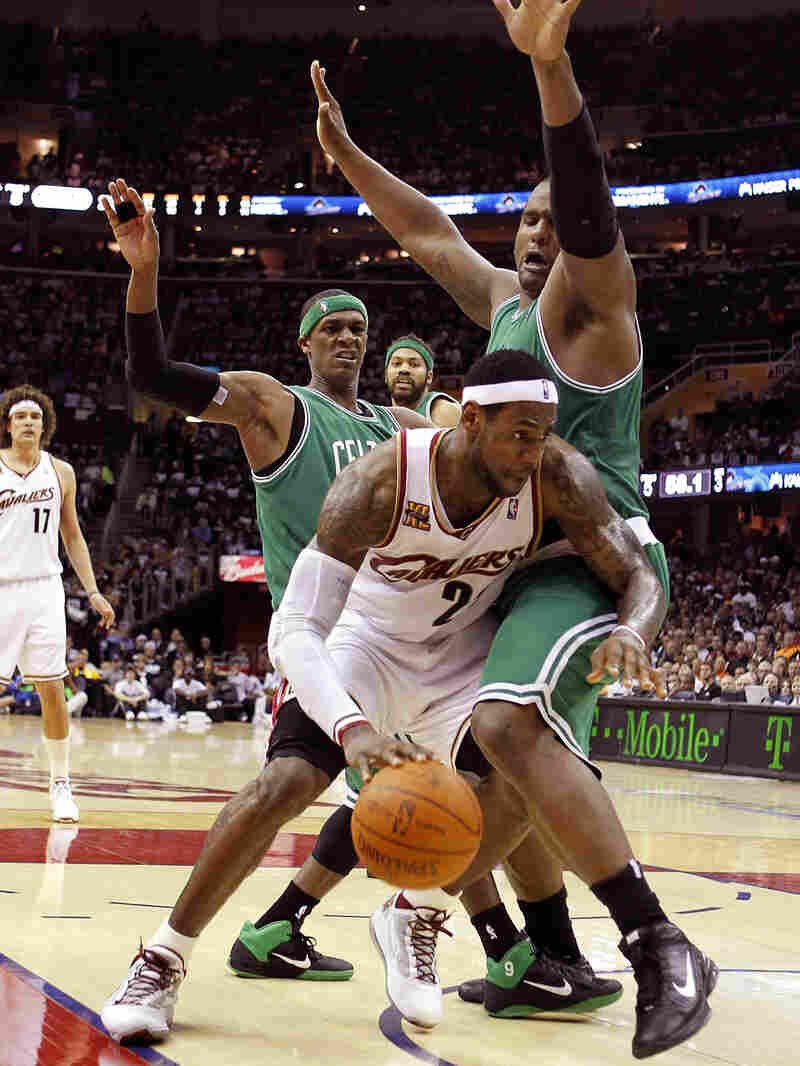 LeBron James of the Cleveland Cavaliers tries to get around the defense of Boston's Glen Davis.