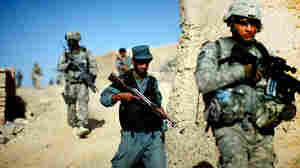 Afghan national police and U.S. soldiers on a joint patrol outside Kandahar city