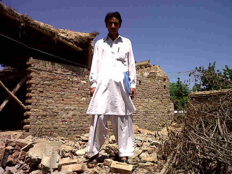 Sami Ullah, 19, stands among the ruins of his demolished home on the outskirts of Mingora, in Swat