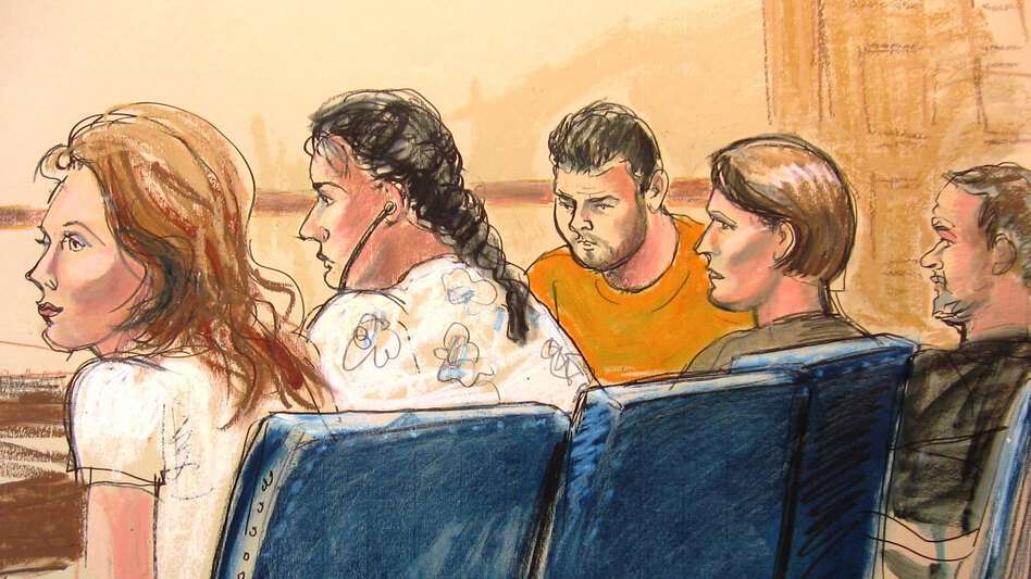 In this courtroom sketch, defendants are seen Monday in federal court in New York. They are among 10 people the FBI arrested for allegedly serving for years as secret agents of Russia's intelligence agency, the SVR, with the goal of penetrating U.S. government policymaking circles.