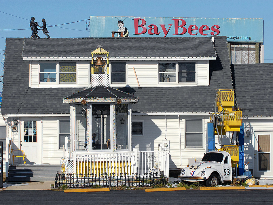 "The ""BayBees"" children's pediatrics office of Dr. Earl Bradley is shown, above, weeks after Bradley was accused of molesting dozens of children at his practice, and, below, after workers removed the signs and attractions, which included a mini-Ferris wheel and carousel."