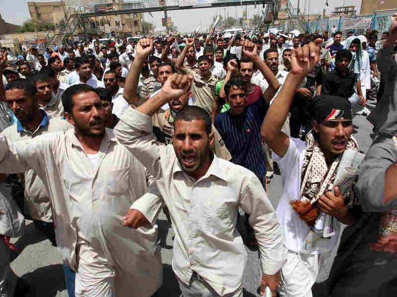 Iraqis protest electricity shortages outside Baghdad.