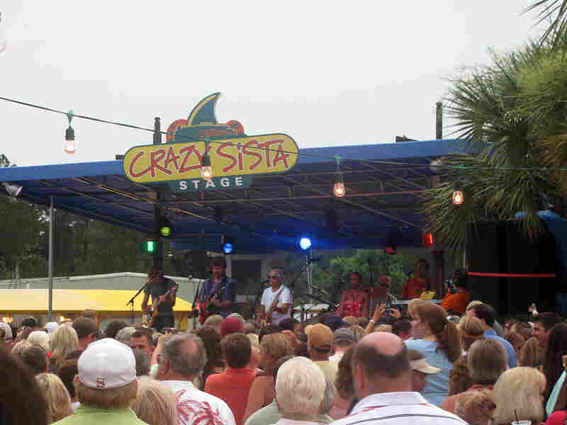 A local crowd in Gulf Shores, Ala., enjoys a surprise show from Jimmy Buffett on Wednesday.
