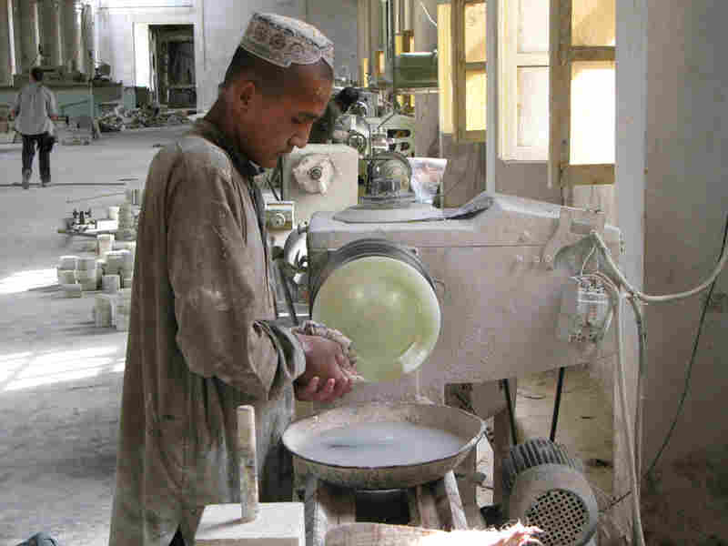 A worker shapes an onyx plate on a lathe at a stone-cutting factory in Lashkar Gah, Afghanistan.