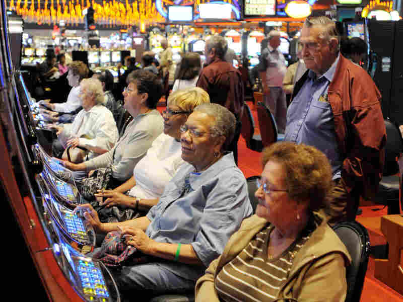 Gambling patrons play the slot machine at the grand opening of a casino in Bethlehem, Pa.