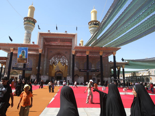 Iraqi Shiite Muslim women arrive at the Imam Musa al-Kadhim mosque in the Kadhimiya district of northern Baghdad on Monday as thousands began converging on the shrine to mark the death of the eighth-century imam.