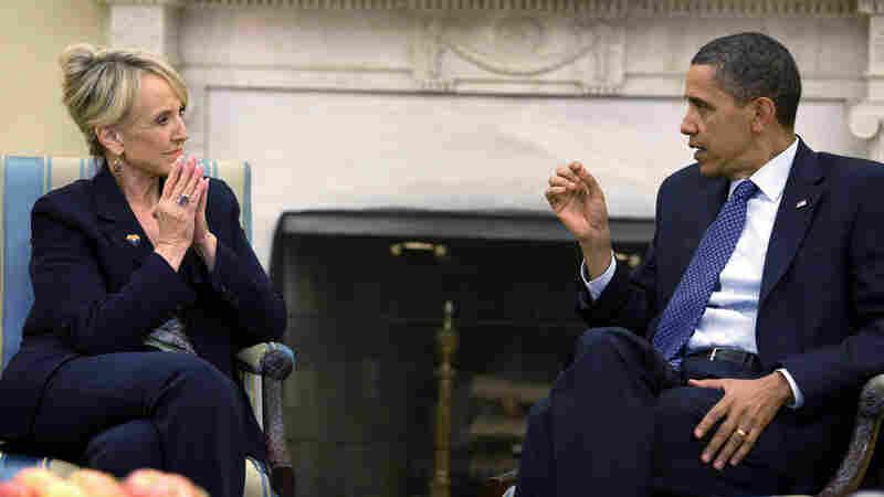 Arizona Gov. Jan Brewer and President Obama.
