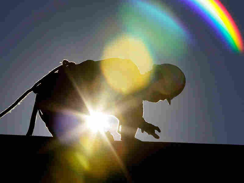 A construction worker bears the brunt of the sun while fixing a roof in Chapel Hill, N.C.