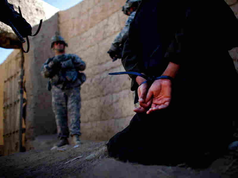 A man suspected of helping the Taliban in grenade attacks