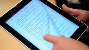 A user flips a book page on an iPad.