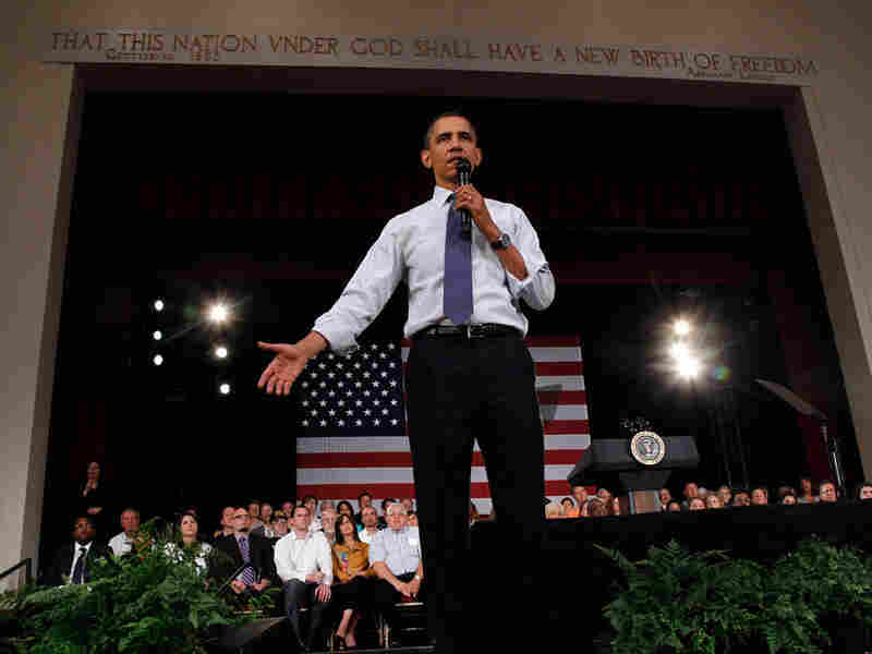 President Obama answers a question in Racine, Wis.