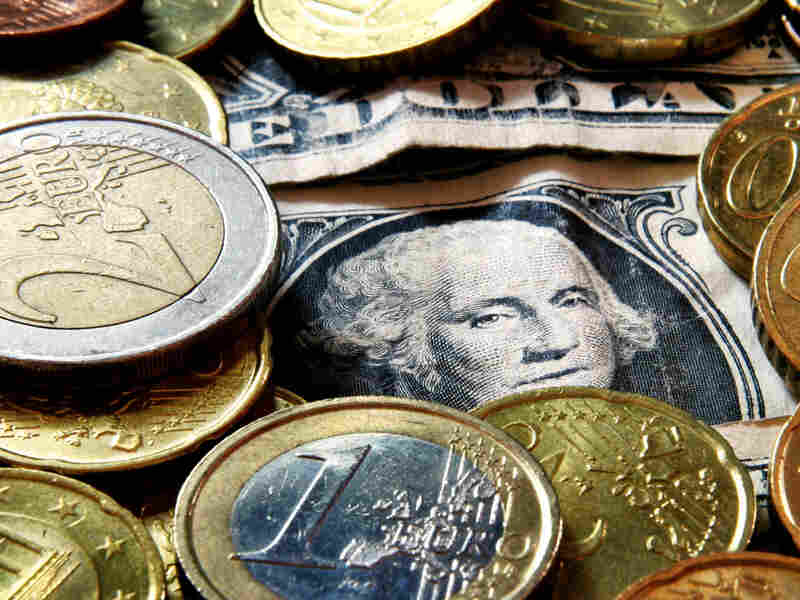 Euro coins and dollar bills