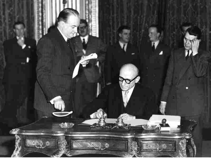French Foreign Minister Robert Schuman signs treaty
