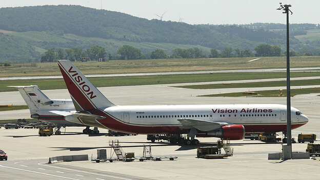 A Vision airlines plane sits on the tarmac at Vienna airport