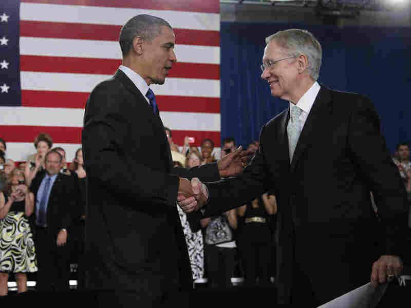 President Obama is greeted by Senate Majority Leader Harry Reid of Nevada.