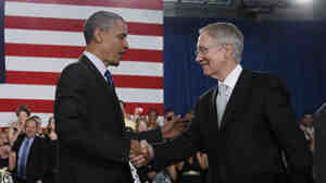 President Obama is greeted by Senate Majority Leader Harry Reid of Nevada.