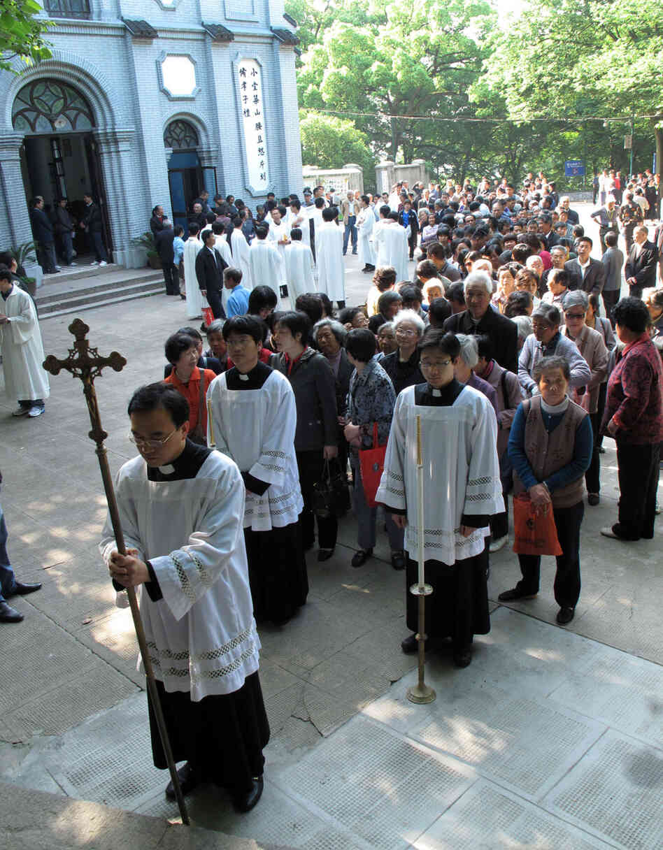 Clergy from the government-sanction Catholic church proceed to the Sheshan basilica outside Shanghai