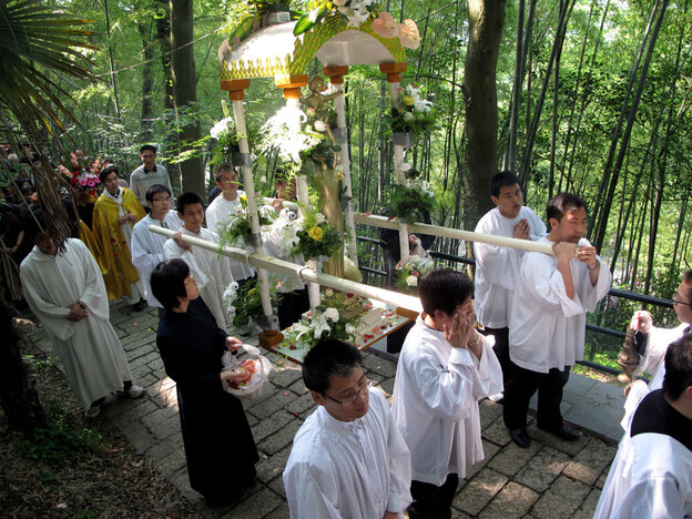 "China's Catholics have traditionally been divided into two churches. One, the ""aboveground,"" or government-sanctioned chucrch, and the ""underground,"" or Vatican-sanctioned church. Here, clergy from the government-sanctioned church hold a procession to the Sheshan basilica, on the outskirts of Shanghai. ("