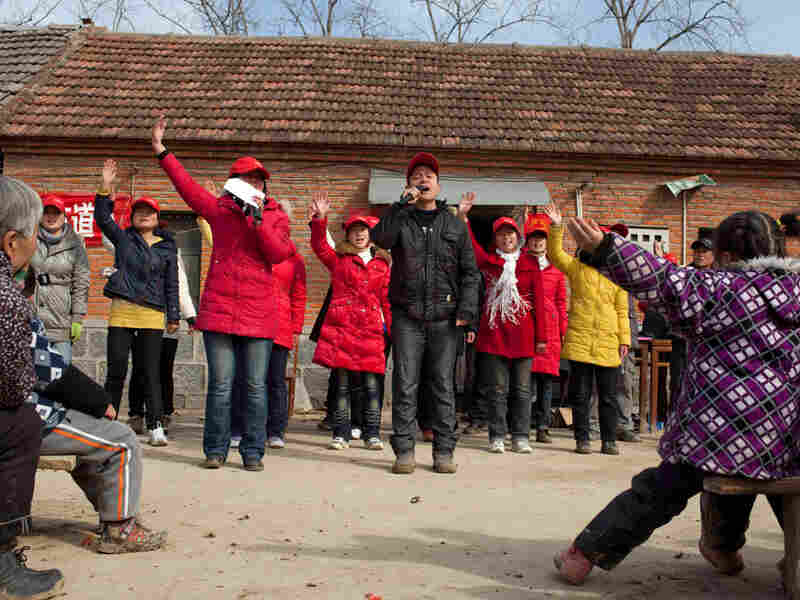 A group of young Christians proselytizes in a rural Chinese village.