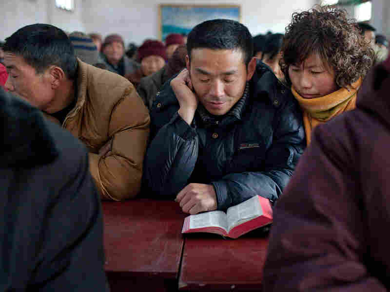 Worshippers attend a service at a Christian church in China's Protestant heartland