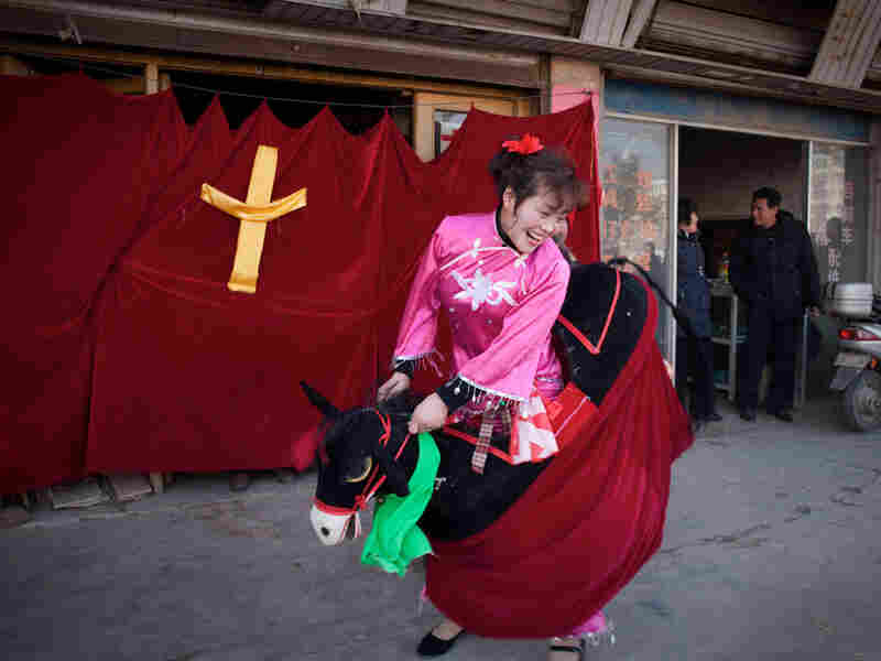 A woman from a government-sanctioned church performs in a Christan-themed street show