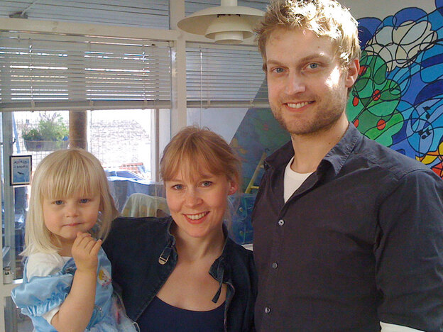 Anders Dalsager and Margit Larsen (shown here with their daughter, Astrid) are graduate students at the University of Copenhagen. They were able to have a child even though they don't have jobs, thanks to subsidies from the Danish government.
