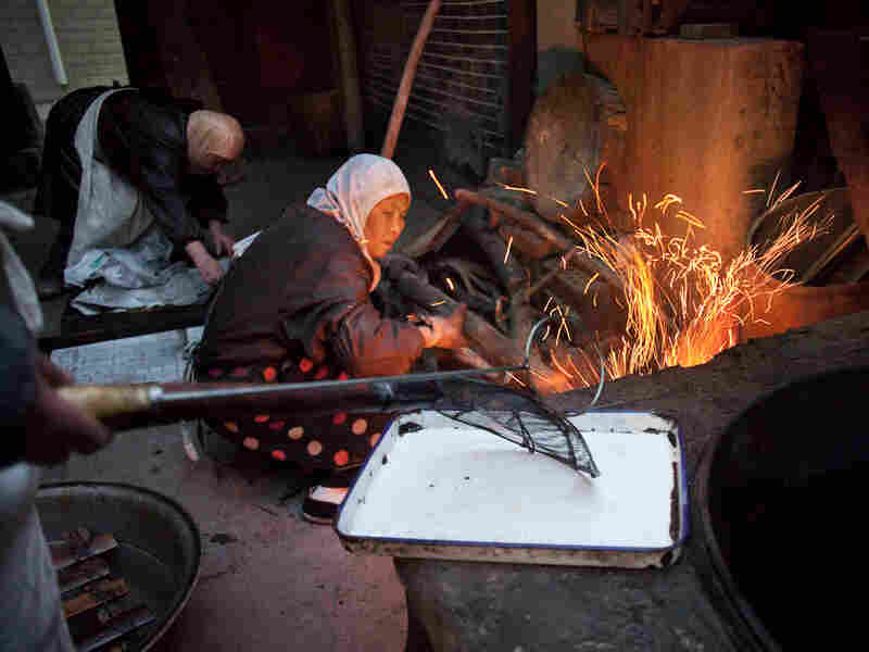 Women at the Wangjia mosque in central China work in the kitchen