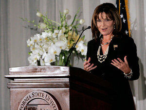 Sarah Palin gestures during her speech at a fundraising dinner.