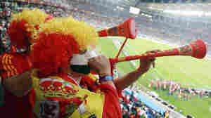 Spain fans play a vuvuzela at the end of the Spain-German match in Durban, South Africa.
