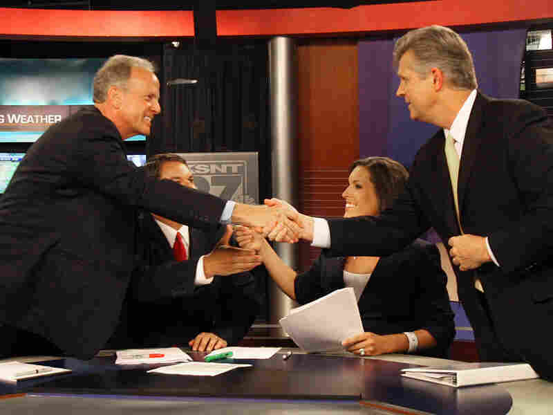 Jerry Moran and Todd Tiahrt shake hands after their first televised debate July 6.