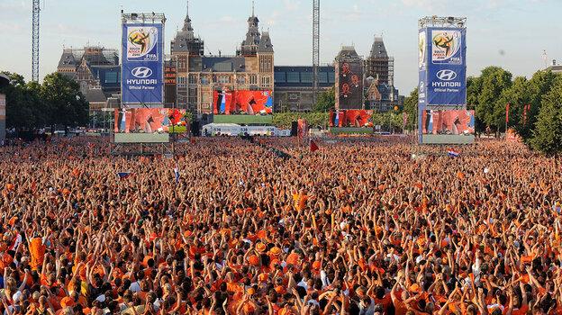 Dutch soccer fans in Amsterdam, Netherlands, watch the World Cup final match