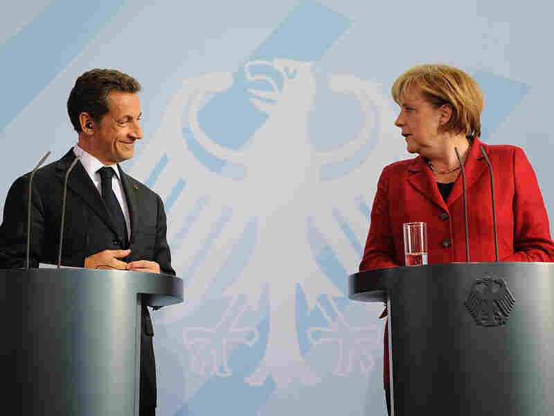 French President Nicolas Sarkozy (left) and German Chancellor Angela Merkel