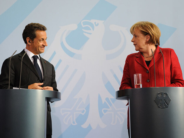 French President Nicolas Sarkozy (left) and German Chancellor Angela Merkel address a press conference in Berlin on June 14. France and Germany are at loggerheads over how to run European economic policy.