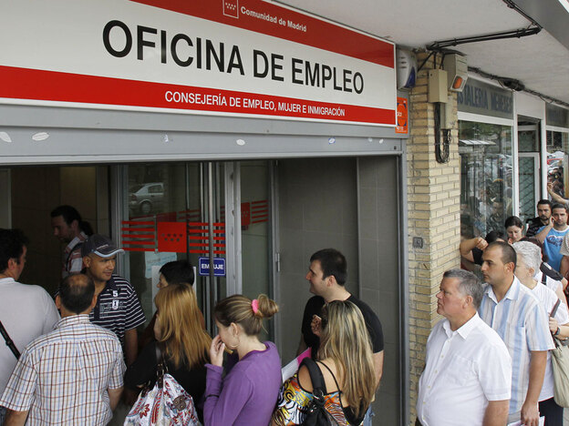 People stand in line outside a government job center in Madrid last month. After Spain adopted the euro in 1999, investment flowed into the country and the economy boomed. Now, it is suffering from the highest unemployment rate in the 16-nation eurozone and grappling with the way to recovery.