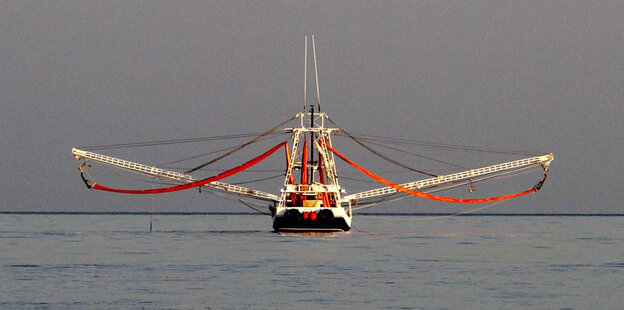 A shrimp boat prepares to lower its booms into the Gulf of Mexico on May 5.