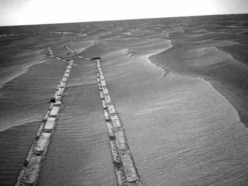 The Mars Exploration Rover Opportunity leaves tracks on the Martian surface.