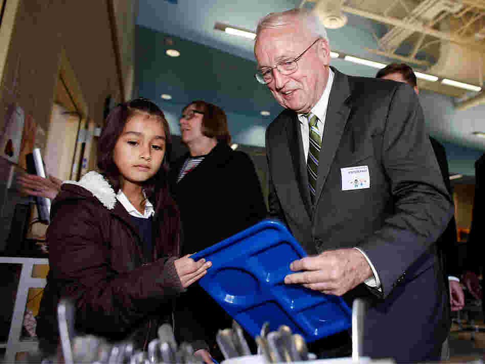 USDA Undersecretary for Food Kevin Concannon meets with kids at an elementary school in Denver.