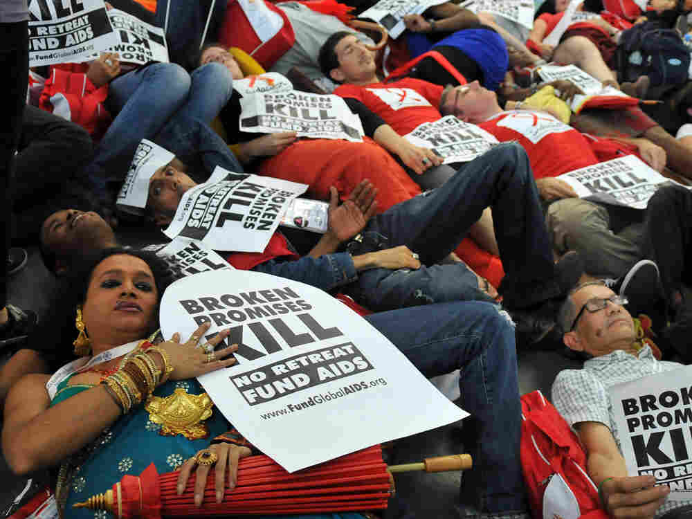 HIV AIDS activists lie on the ground
