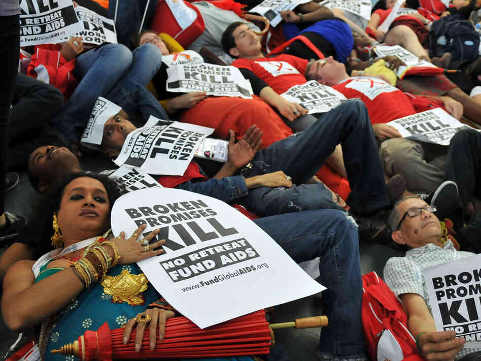 HIV AIDS activists lie on the ground