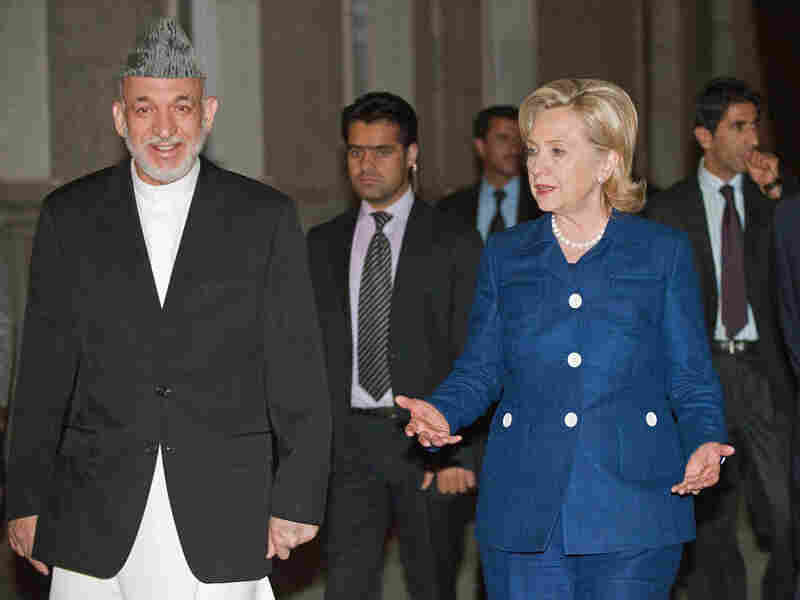 Secretary of State Hillary Clinton, right, is greeted by Afghanistan President Hamid Karzai in Kabul