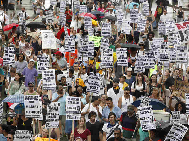 Demonstrators march in Boston to protest a controversial new Arizona immigration law.