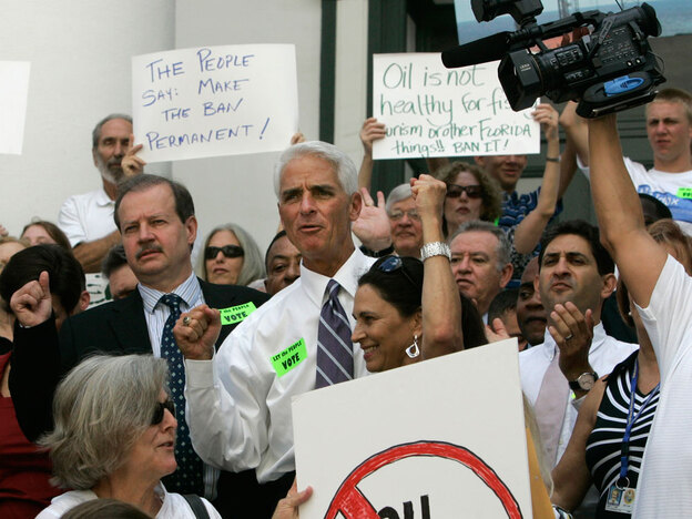 Florida Gov. Charlie Crist (center) participates in a rally on the steps of the old Capitol before the start of the special legislative session in Tallahassee on Tuesday. The demonstrators urged lawmakers to allow a constitutional amendment banning offshore oil drilling on the ballot.