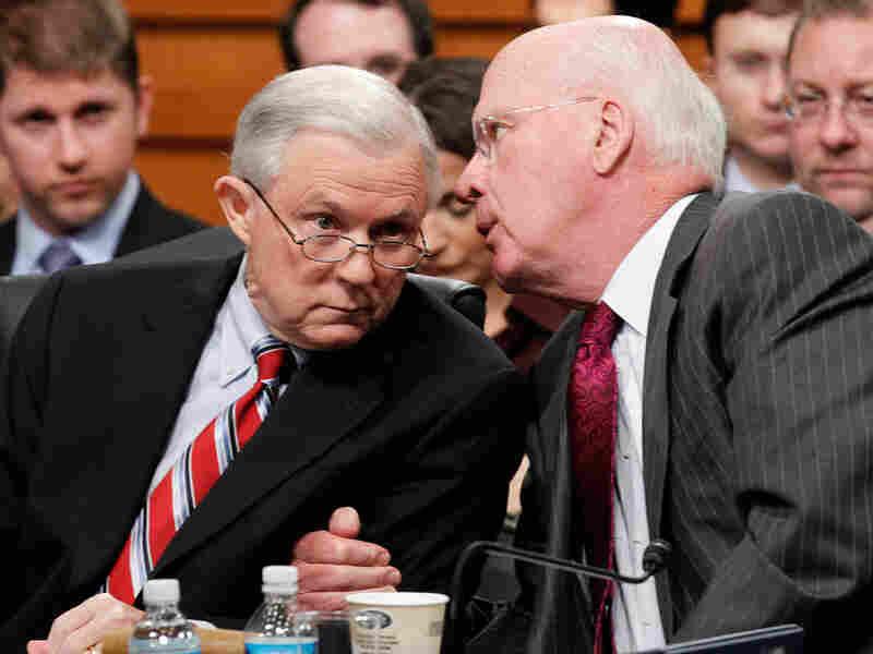 Senate Judiciary Chairman Patrick Leahy talks with ranking Republican Jeff Sessions