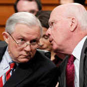 Senate Judiciary Chairman Patrick Leahy talks with ranking Republican Jeff Sessions