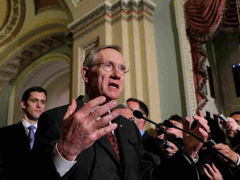 Senate Majority Leader Harry Reid speaks with reporters