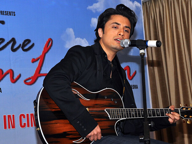 Pakistani pop singer Ali Zafar performs at a press conference for the Indian Bollywood film <em>Tere Bin Laden</em> in Mumbai on June 21.