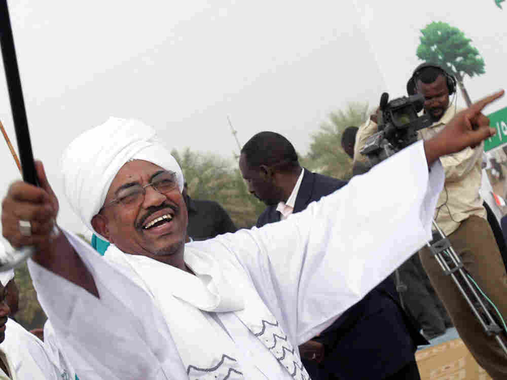 Sudanese President Omar al-Bashir greets supporters