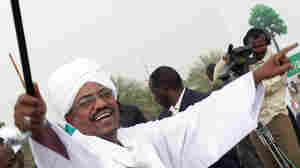 Sudanese President Omar al-Bashir greets supporters