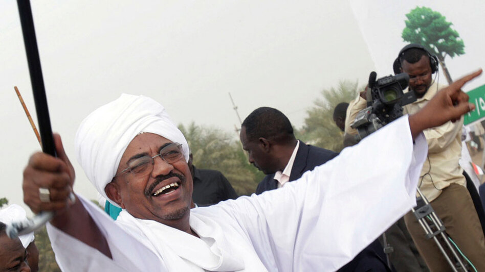 Sudanese President Omar al-Bashir greets his supporters during a rally in Khartoum on May 1.